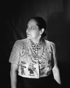 Helena Rubinstein wearing her celebrated Schiaparelli bolero jacket, embroidered with elephants, from the designer's 1938 Circus collection. © Roger-Viollet / Image Works
