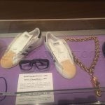 D.M.C. Eyeglass frames and shoes, c. 1985, collection of Darryl McDaniels. Jam Master Jay's gold chain, c. 1985, collection of Terri Mizell